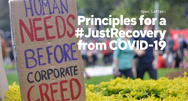 A sign reads human needs before corporate greed with a title saying Principles for a Just Recovery from COVID-19